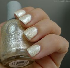 Orly Winter Wonderland over a white creme nail polish. Winter Wonderland changes a stark white polish up to a cream and looks quite pretty.
