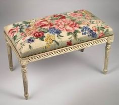 Needlepoint floral motif on piano bench.