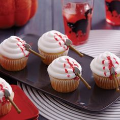 Startle Halloween party guests with cupcakes that look gruesome but taste yummy! Make them using Wilton® Battle Axe Royal Icing Decorations and Wilton Blood Red Sparkle Gel.