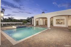 Contemporary Swimming Pool with exterior tile floors, Fence, Pool with hot tub