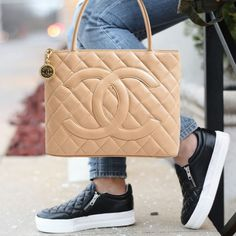 We guarantee the authenticity of this bag or your Full Money Back. The bag has been inspected and authenticated by our experts. Description: Authentic Chanel Medallion Tote Bag Details: Tan Quilted Ca