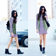Wafaa H. - Stripes and a military vest
