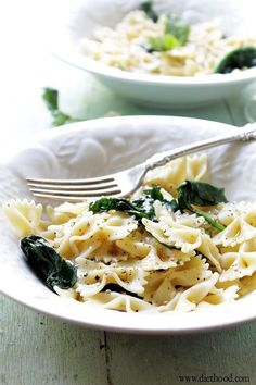 Garlic-Butter Spinach and Pasta: Fresh spinach and bow tie pasta tossed in a delicious and warm garlic-butter sauce.