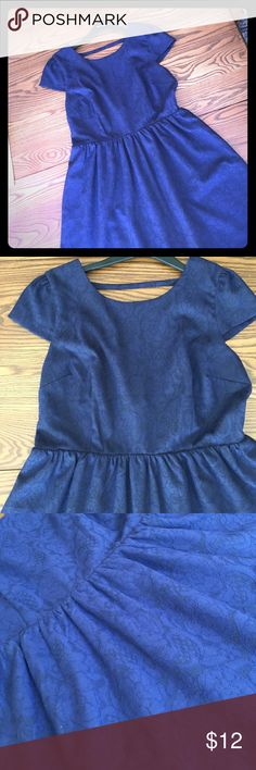 Black and Blue Short Sleeve Fit and Flare Dress Thanks for looking! For Sale - a Forever 21 Contemporary Women's Dress in Large. It's a scoop back with a cross strap up top. It's great shape, probably worn once or twice! Forever 21 Dresses Mini