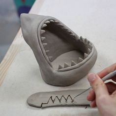A peak at how I make shark heads. I cut out the teeth in a row but then I have to go back and sharpen each one . Pottery Tools, Slab Pottery, Ceramic Pottery, Pottery Art, Thrown Pottery, Pottery Studio, Clay Art Projects, Ceramics Projects, Pottery Sculpture