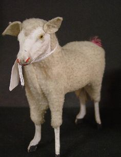 PUTZ SHEEP.  I've got some of these, but would love for somebody to  exactly explain to me what they are...except cute.