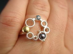 Ring | Danielle Miller-Gilliam. Sterling silver, 18k gold, blue topaz, pearl.