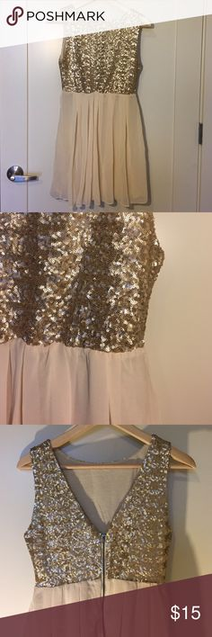 Sequin dress Sequin top and flowy bottom. It has a v in the back and swoop neck in the front. tfnc London Dresses Mini