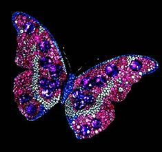 a pink and purple butterfly brooch in rubies, sapphires, amethysts, diamonds, silver and gold, 1987.