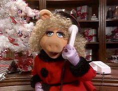 Miss Piggy  talking on the phone