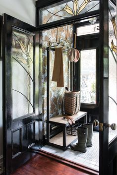 In the entry vestibule of this character-filled home, an industrial hall tree topped with bamboo hat holders adds a functional element to a diminutive space. Future House, Decoration Hall, Entry Hallway, Door Entry, Porch Entry, Front Entry, Small Room Design, House Entrance, Entrance Halls