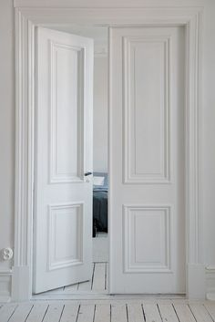 Classic European two-panelled double interior doors in painted timber