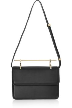 Handmade Black leather (Calf) Adjustable detachable shoulder strap, signature metal top handle Designer-stamped gold hardware Three internal compartments Fully lined in black leather Concealed magnetic fastening at front