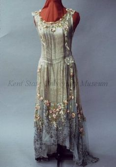 ca 1928  Attributed to Boué Soeurs. Brocade silver lame, blue net, silk floral trim, sequins. Chemise style, sleeveless, dropped waist, net trim at hem. Possible robe de style dress, missing panniers.