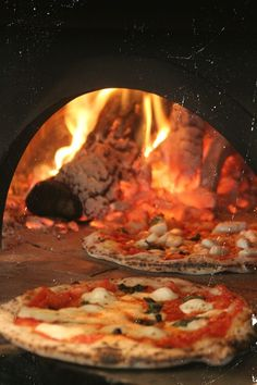 Tomato caprese/margherita pizza in an old fashioned Italian oven
