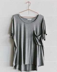 Basic Grey Tee - Blossom & Glow Maternity.  You asked for it, so here it is, the Basic Grey Tee!  We love this basic for layering during winter.  A soft jersey fabric, and slightly longer length at the back, its fit is perfect for all shapes and sizes.  Team it with our joggers, or skinny jeans, add a pair of cons, and you've got the perfect weekend look!  Also available in white stripe, charcoal, white, and black stripe.