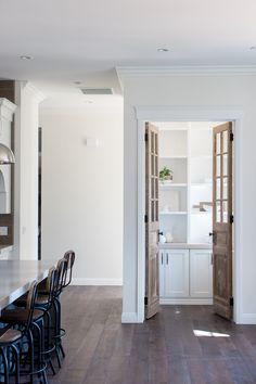 Custom antique doors we repurposed as pantry doors for a home we built.