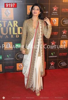 Jacqueline Fernandez went desi in an Anand Kabra sari which she wore wih a long golden blouse at the Star Guild Awards Lehenga Sari, Saree Dress, Anarkali, Jacket Lehenga, Saree Draping Styles, Saree Styles, Blouse Back Neck Designs, Saree Blouse Designs, Saree Jacket Designs Latest