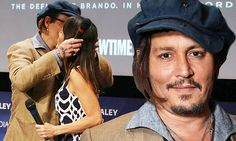 (1-4-16) Johnny Depp gives a kiss on the cheek of Marlon Brando's daughter, Rebecca at doco screening of Listen To Me Marlon in Los Angeles.  JD was a close friend of Marlon and knows Rebecca since her childhood.