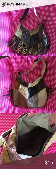 Genuine leather purse Multi tone genuine leather purse from out west!  One of my favorites. Used condition. Bags Shoulder Bags