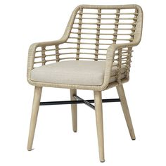 Hardwood frame and legs accented with pole rattan details on back and sides. With fixed upholstered seat.  Fabric: Linen Ecru