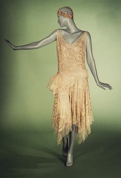 """Evening ensemble  designed by Jeanne Lanvin.  Spring/summer 1923.  """"This Lanvin dress is very indicative of 1920s fashionable dress. Its intricate embroidery is unique to France while the spiral motif is a Lanvin signature""""."""