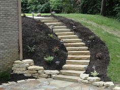 Landscaping on a slope stone stairs
