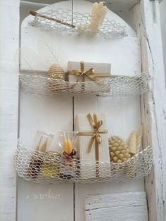 I love this idea of like a net hanging up some decor ( sea shells and star fish)