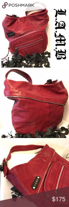 """L.A.M.B. Hobo Beautiful, soft red leather L.A.M.B. Hobo. Zipper trim around the top with two front pockets and silver hardware.  Black L.A.M.B logo cloth interior.  One zippered pocket and two open.  Wide adjustable strap.  Drop is 4-6"""". Bag is nearly pristine except for a couple small dark spots on the back.  Barely noticeable and may fade with conditioning. 1822 Denim Bags Hobos"""