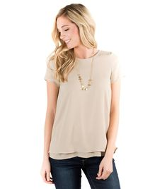 """- Model: Malery, is 5'9"""" and wearing size XS - Short sleeve blouse with cut-away back overlay - Button closure at back necline - 100% Polyester woven fabric"""