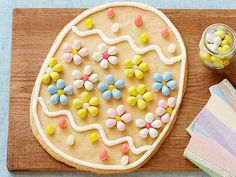 Giant Easter Egg Cookie: Save time by using store-bought cookie dough for this giant treat. Top with homemade icing and attach candies in patterns to make a decorative Easter egg.