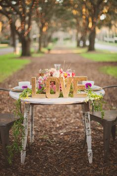 Table decor; anniversary shoot  http://www.greylikesweddings.com/inspiration-shoots-and-boards/by-color/purple-inspiration/valentines-day-elopement/