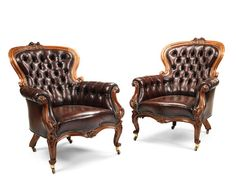 A pair of large early Victorian Rococo revival walnut library bergeres.
