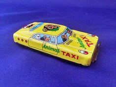 "Tin Toy Japan Animal Taxi K Friction Litho 1960's 4 3"""