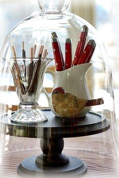 Kitchen Cloche ~ Smart idea for the 'staple' items to have on a classy lazy susan on the breakfast table.
