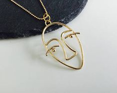 Abstract tribal face necklace , Art Deco jewellery, hollow face necklace , tribal jewellery , gold face , abstract jewelry , gold , face ,