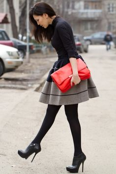 Oh my, that skirt with those heels.  And the red bag.  I am in love.