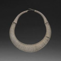 China | Miao necklace from Geyi, Guizhou Province.  Although the original description said that it was made of silver, far more likely that it is made from paktong, the choice alloy (Not a silver alloy)