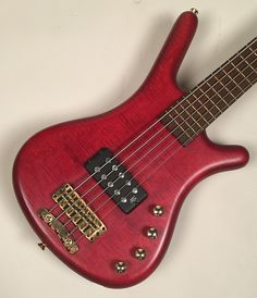Ref#   00532 - 1999 Warwick FNA 5-String Bass in a Cherry Flamed Ash Body with   Wenge fret board, Ovangol neck from the good 'ol days. These basses   were a cut above most basses of the time, in my opinion. She's as   clean as I've ever seen one, for sure! She weighs in at 9.4 pounds with   just a killer 5-string thin neck. A slimmer jazz style neck profile I   would say. Three band EQ and an MM style pickup. The pickup is a bit   closer to the neck which makes it a dream to play, p