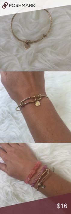 Alex & Ani Gold Bracelet Alex & Ani gold Bracelet. Gently worn, some tarnish on small flag charm. Alex & Ani Jewelry Bracelets