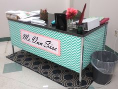 My classroom teacher desk that I designed using wrapping paper and construction paper.  I used regular tape to attach it to the desk and it has lasted me ALL year! (I've done this for four years now!) Makes the room feel brighter, too! (Miss Van Sise - High School English and Reading)