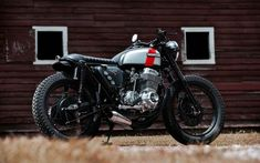 A garage for special motorcycles and cafe racers Cb 750 Cafe Racer, Cafe Racer Parts, Cafe Racer Honda, Custom Cafe Racer, Cafe Racers, Honda Cb750, Firestone Tires, Cafe Racer Motorcycle, Brat Bike