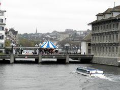 Rathausbrücke over the Limmat River, Zurich, Switzerland | Zürich Town Hall to the right.
