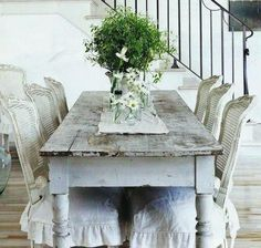Distressed table with French chairs