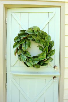 Magnolia Wreath ~ Magnolia Leaf Wreath ~ Farmhouse Wreath ~ Cottage Wreath A beautiful faux magnolia leaf wreath made with realistic artificial magnolia leaves and attached to a natural grapevine base. A beautiful indoor or outdoor wreath. This wreath is perfect year round. It would look great on your front door or mantel or as part of a gallery wall. The wreath measures approximately 22 in diameter. There is a small wire hanger on the back. If this is a gift, I would be glad to include a…