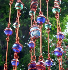 Rainbow Chakra Suncatcher with Copper Wire Wrapped Glass Marble Prisms, Metaphysical, Home Decor, Garden Decor by tapestryarabianfarm on Etsy https://www.etsy.com/listing/198879286/rainbow-chakra-suncatcher-with-copper