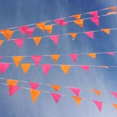 Pink & orange bunting float over the Brooklyn sky.