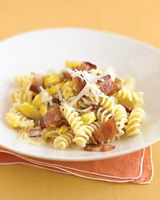 Lots of sauteed yellow squash in this rich, carbonara-inspired sauce offsets the indulgent bacon topping. Parmesan can stand in for the Asiago cheese, if you like.