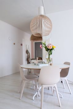 The bowl-shaped dining chairs from IKEA are a mix of renewable wood and recycled plastic. They look just lovely with the round dining table from HAY.