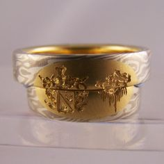 mokume gane rings with family crests & gold inlays 2 #jewellery #jewellerydesign #jewelleryonline #jewelleryset #jewelleryshops #bespoke #asschercut #diamond #diamondrings #style #sapphire #emerald #emeraldring #sapphirering #wedding #weddingrings